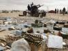 A rebel mans an anti-aircraft gun in Ras Lanuf